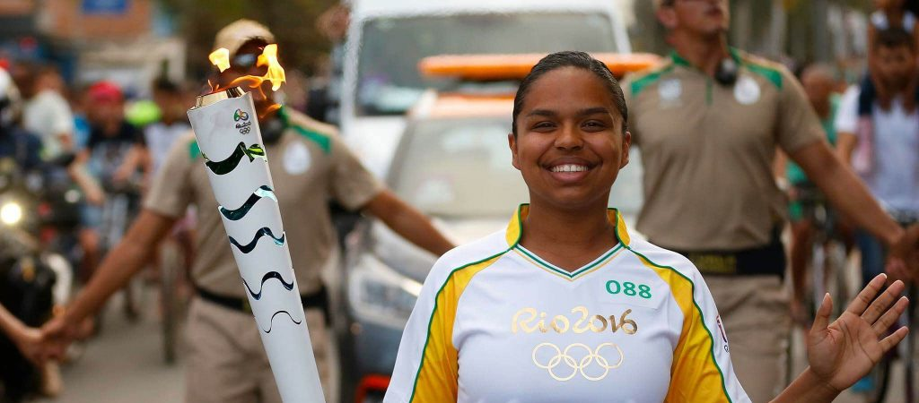 UCONN Alumna carrying Olympic Torch